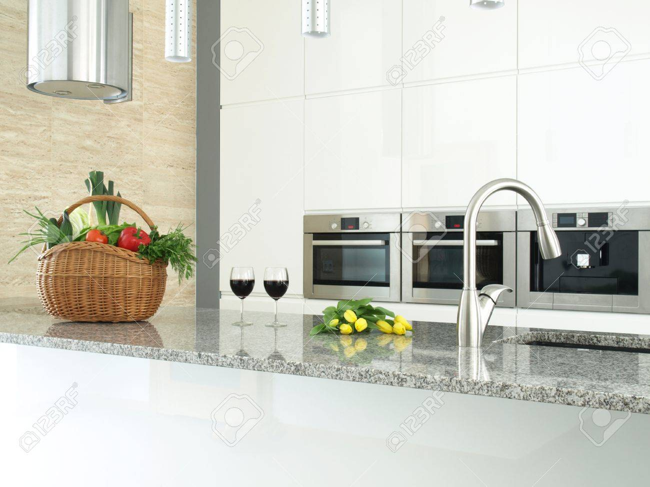 Modern kitchen interior with vegetables, glasses of wine and flowers Stock Photo - 12515205