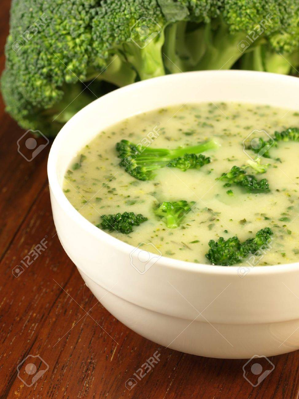 Creamy soup with broccoli served in white bowl Stock Photo - 13211602