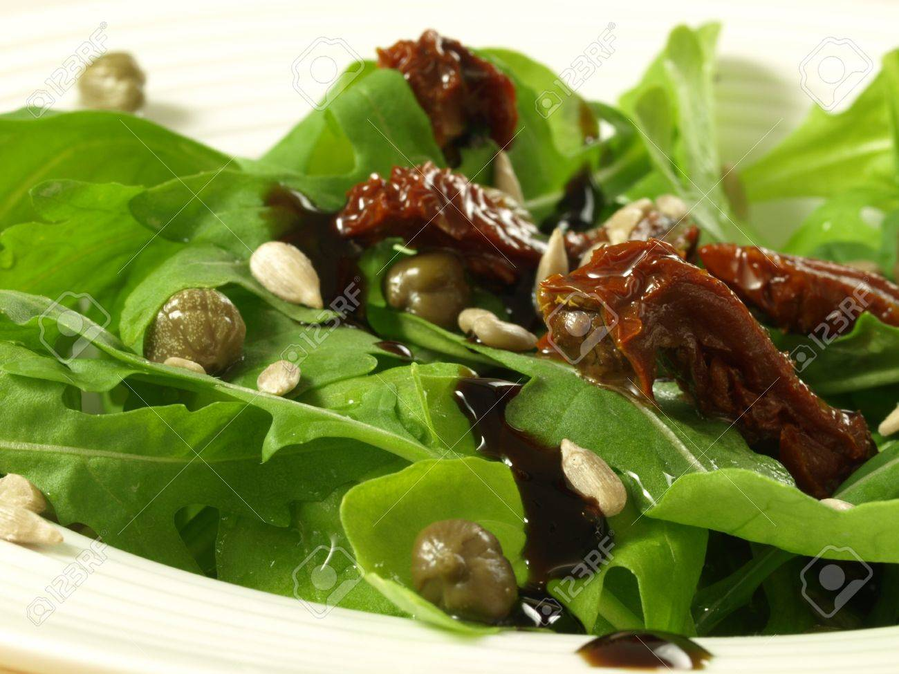 Closeup Of Wild Rocket Salad With Sun Dried Tomatoes Stock Photo 14054479