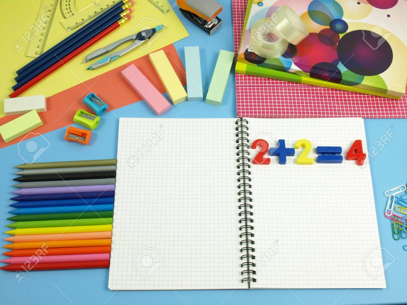 Colorful school equipment on a blue desk Stock Photo - 14600930