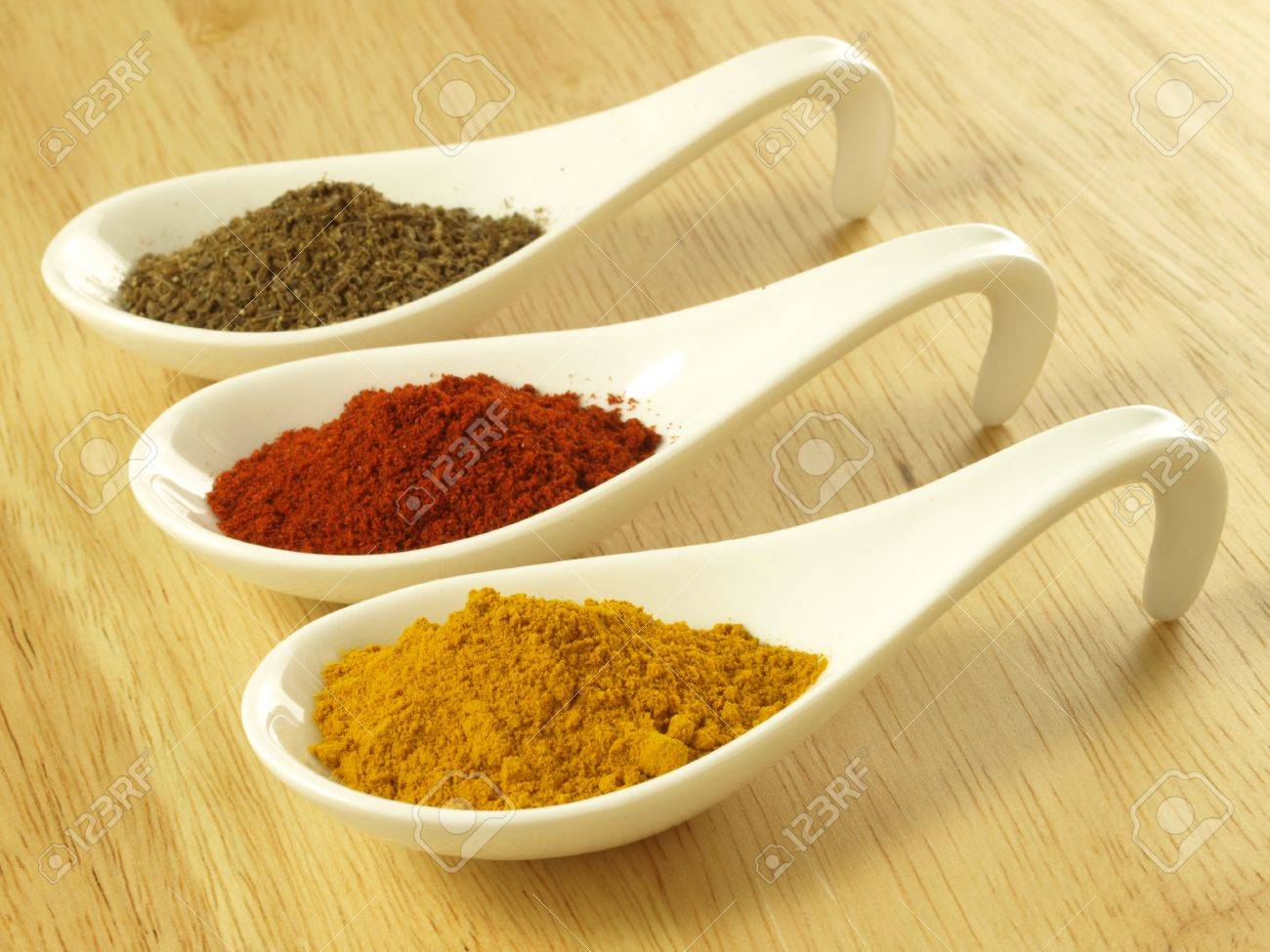 Indian cuisine additions: cumin, turmeric and pepper Stock Photo - 14739730