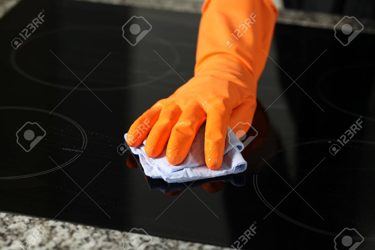 Closeup of cleaning a cooker with rubber Stock Photo - 14832404