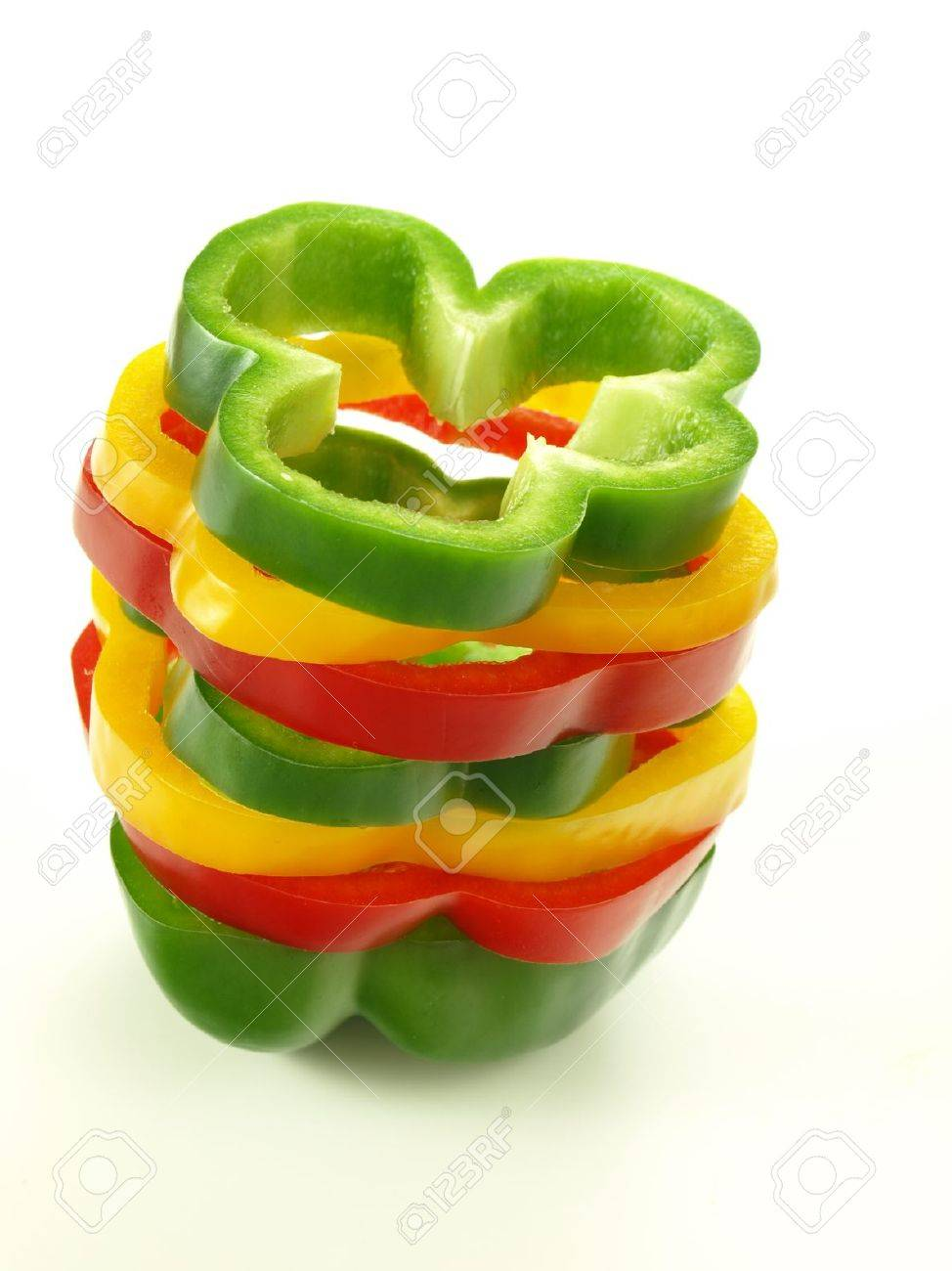 Tri-color sliced pepper on isolated white background Stock Photo - 14974509