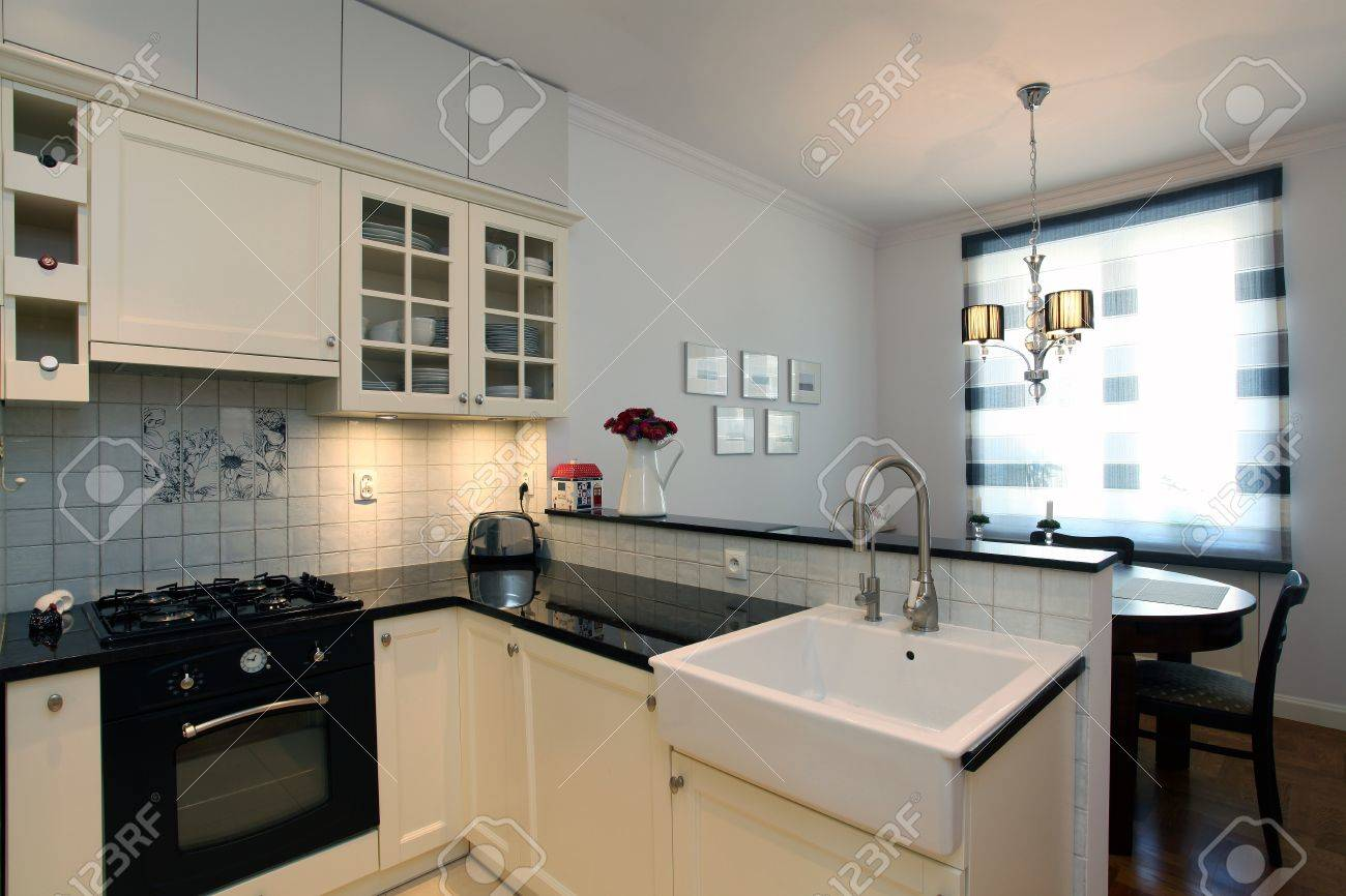 New Stylish Kitchen With Small Dining Room Stock Photo