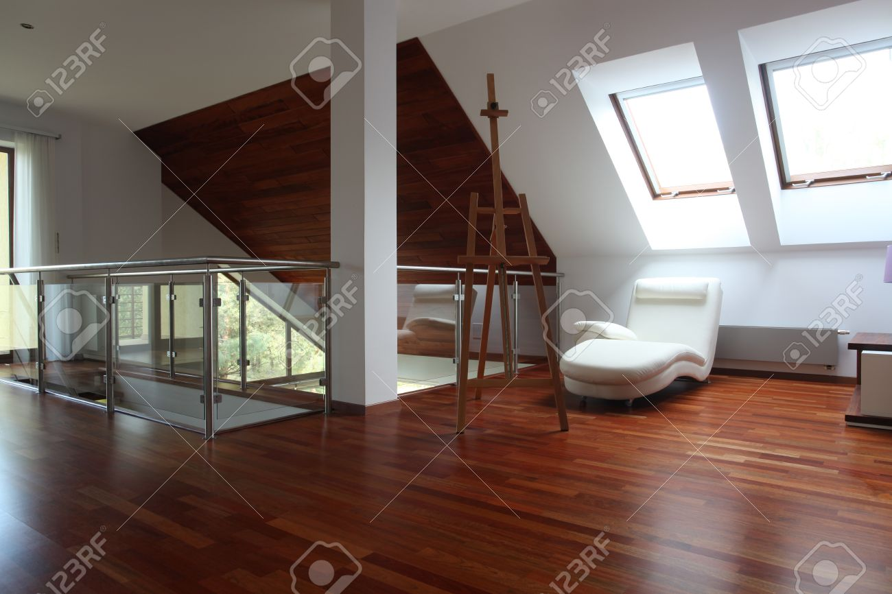 Contemporary artist apartment with easel and comfortable chair Stock Photo - 15784237