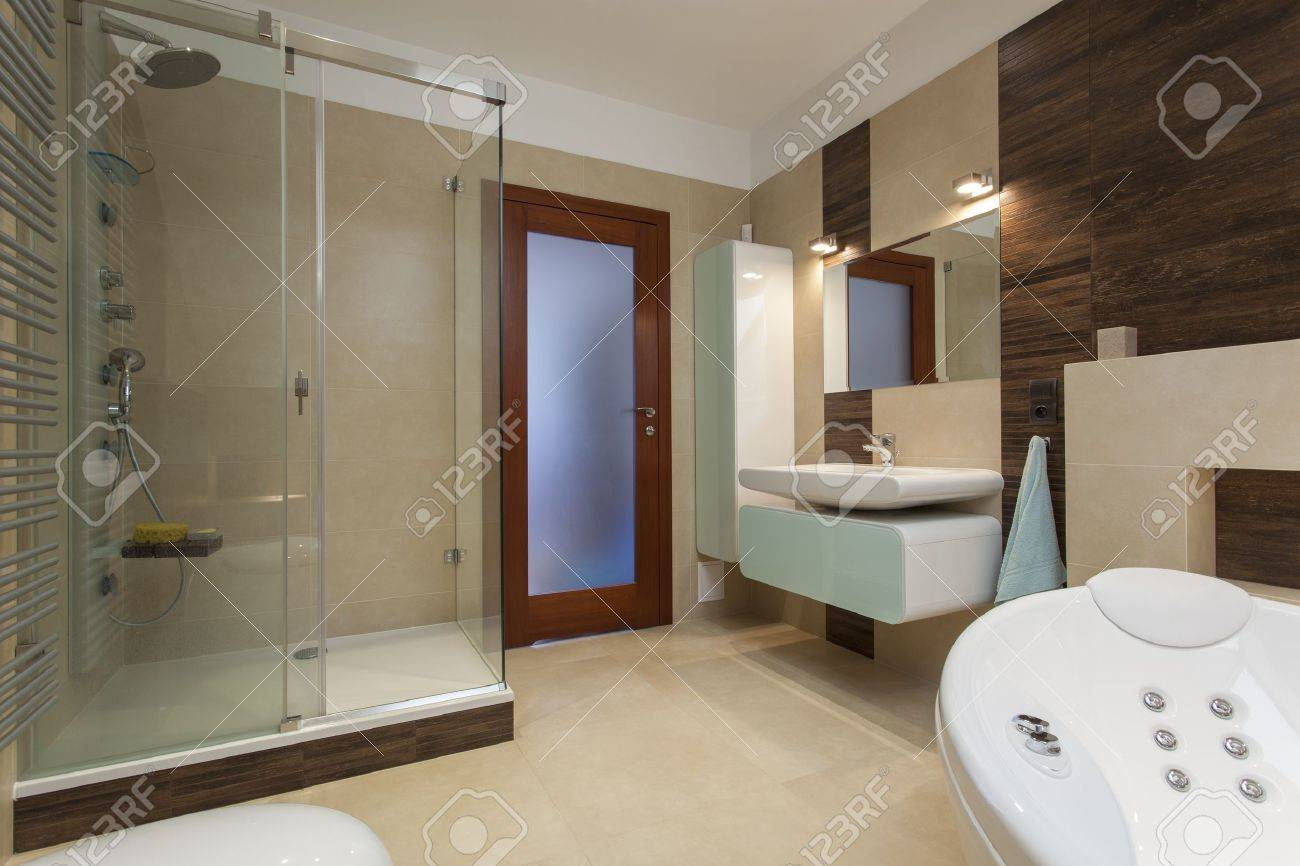 Elegant Bathroom Interior With Bath And Shower Stock Photo, Picture ...