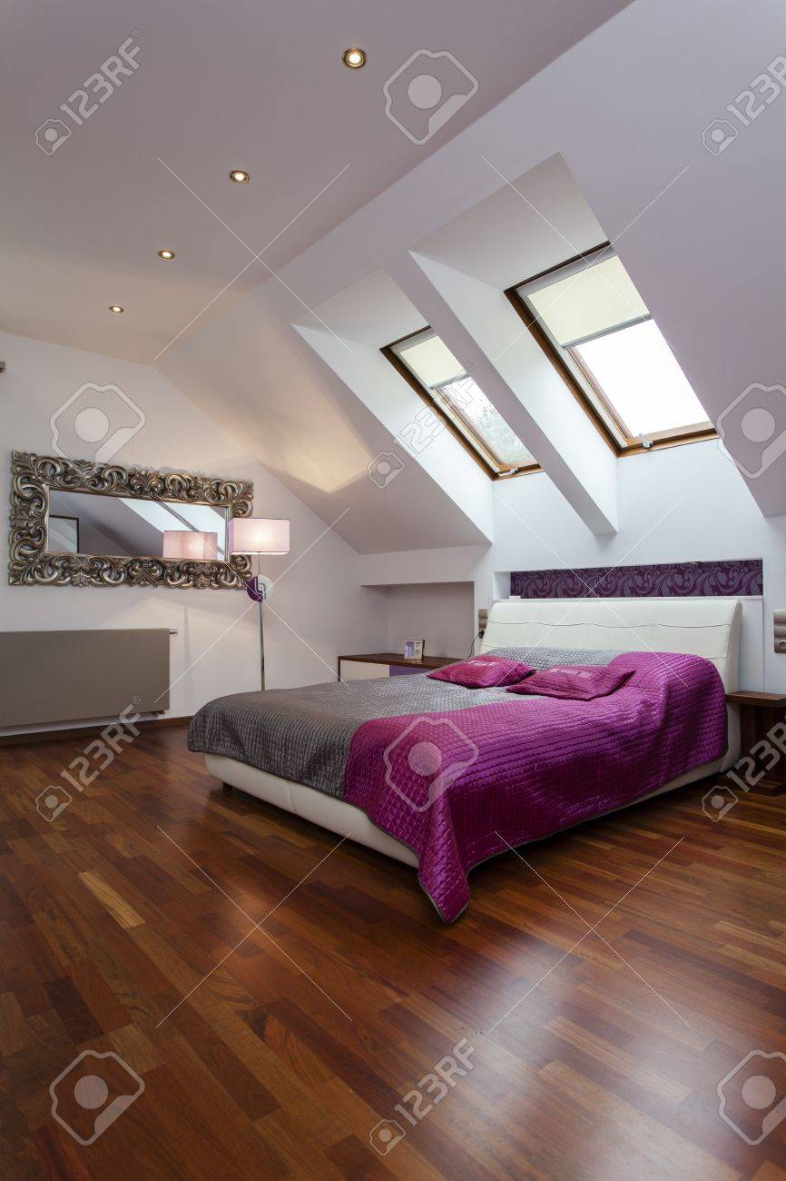 Spacious bedroom with purple and silver bed Stock Photo - 15895763