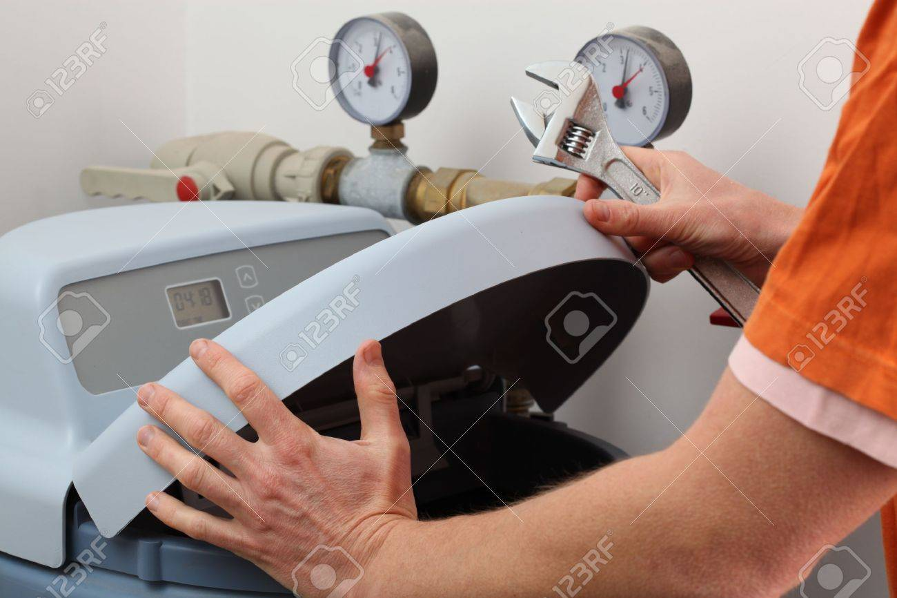 How To Repair A Water Softener Repairing Water Softener Plumber With A Wrench Stock Photo