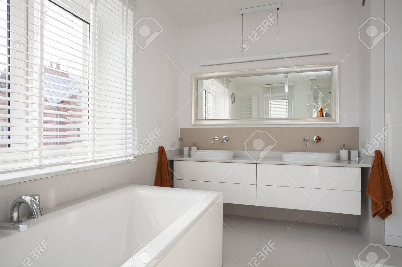 Interior of spacious, plain and white bathroom Stock Photo - 16158872