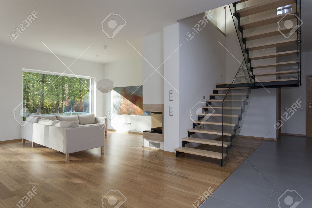 Spacious living room and wooden staircase Stock Photo - 16164868