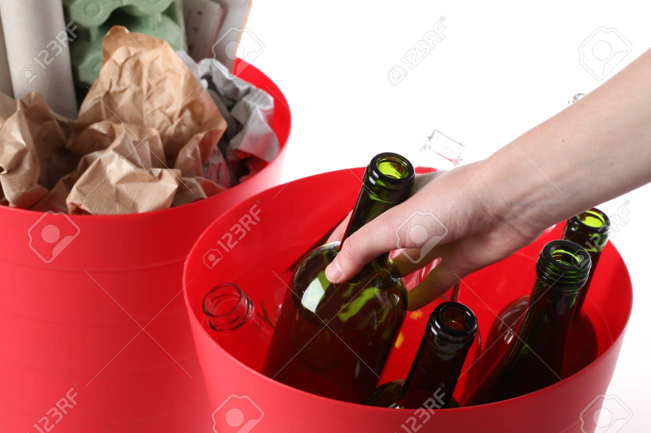 Putting glass bottle into recycling basket, isolated Stock Photo - 16250986
