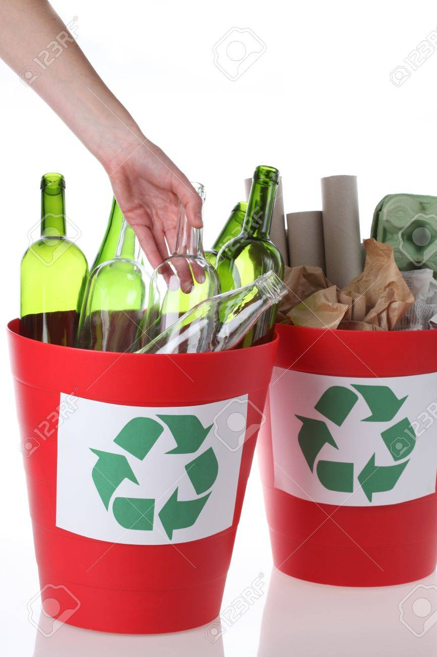 Environmental care- putting glass bottles into recycling bin Stock Photo - 16250983