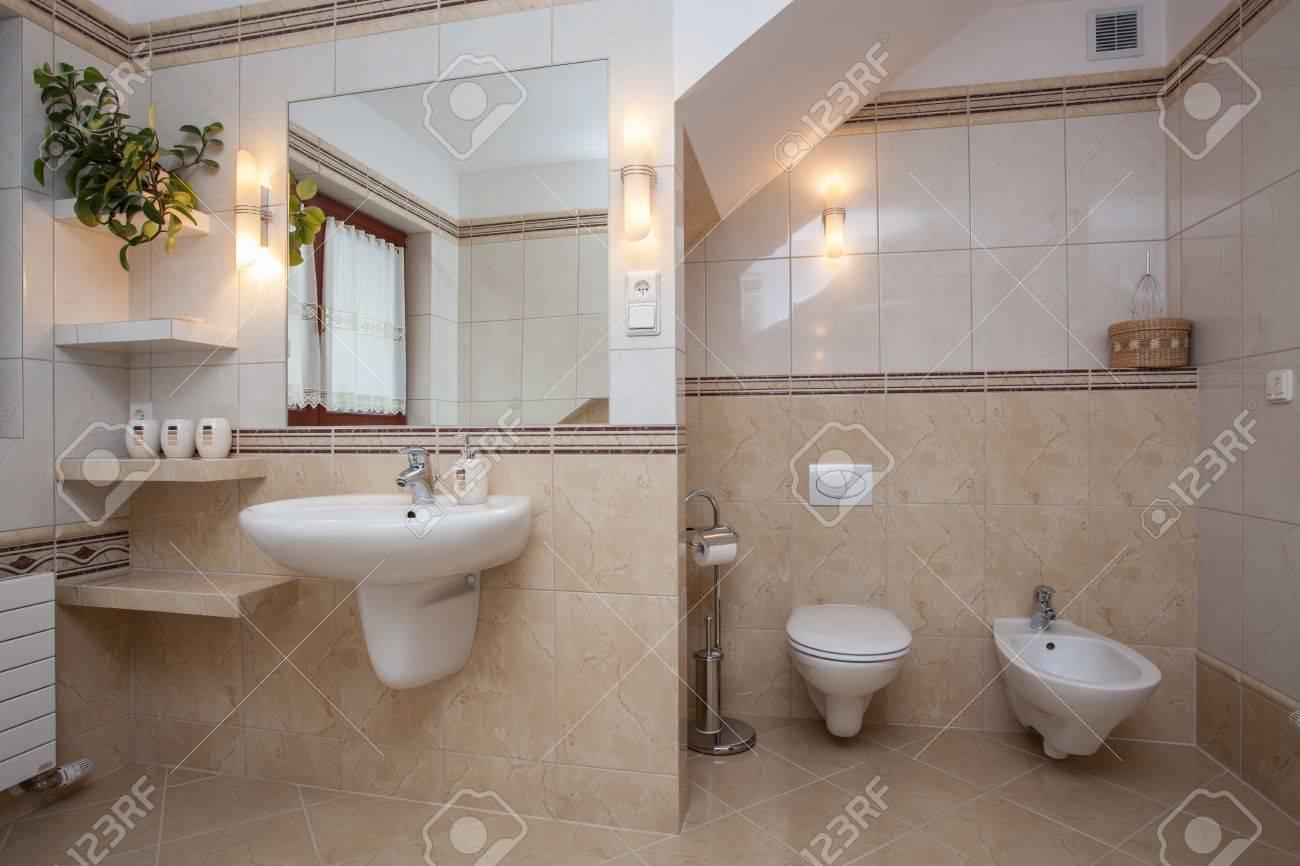 Interior Of Creamy Bathroom, Sink, Toilet And Bidet Stock Photo ...