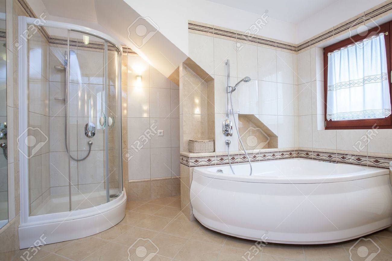 Shower And Big Bath In Beige Bathroom Interior Stock Photo, Picture ...