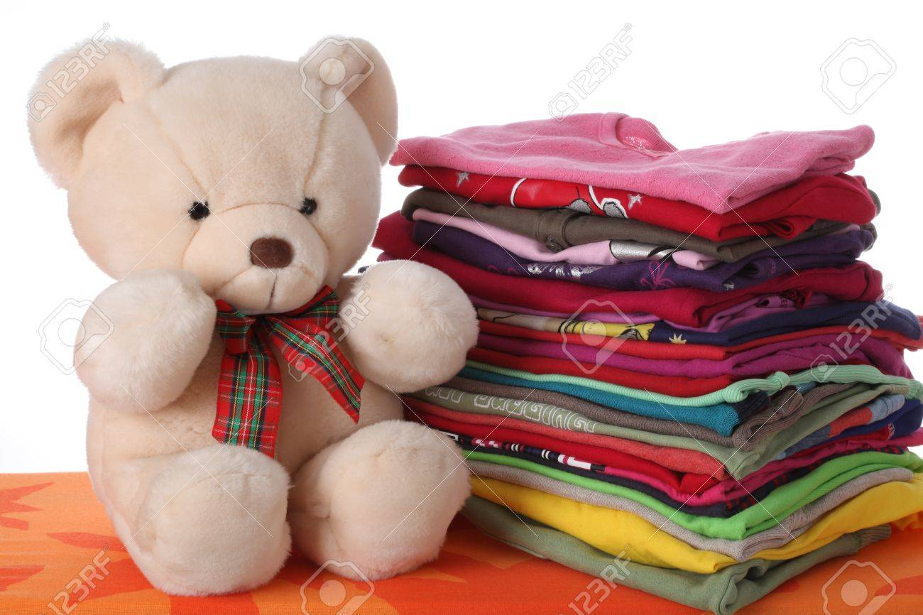 Colorful children's clothes with a teddy bear Stock Photo - 16685368