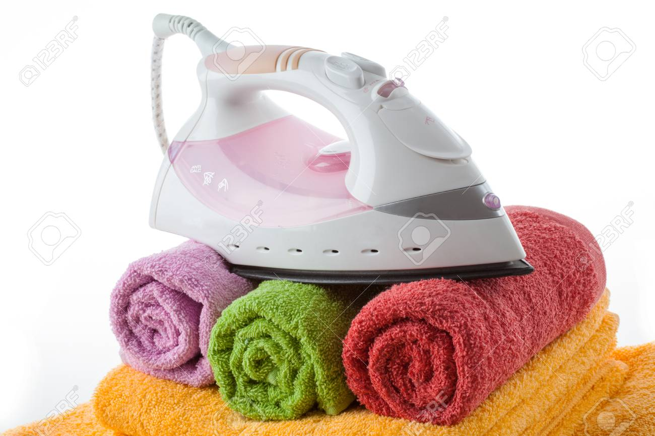 Iron on rolled up and colorful towels,  isolated Stock Photo - 16756020