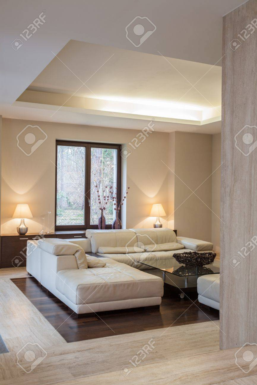 travertine house comfortable sofa in modern interior stock photo