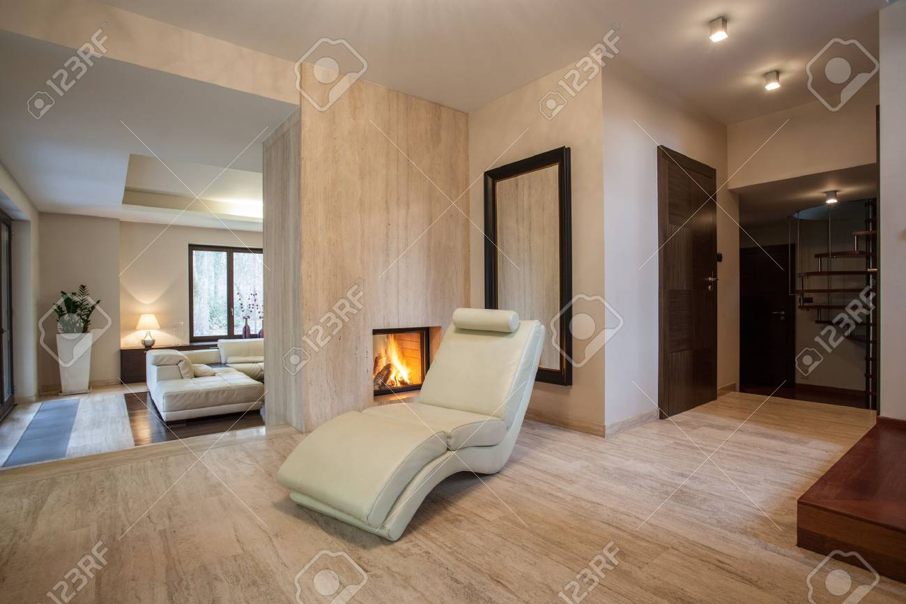 travertine house hallway and view of living room stock photo