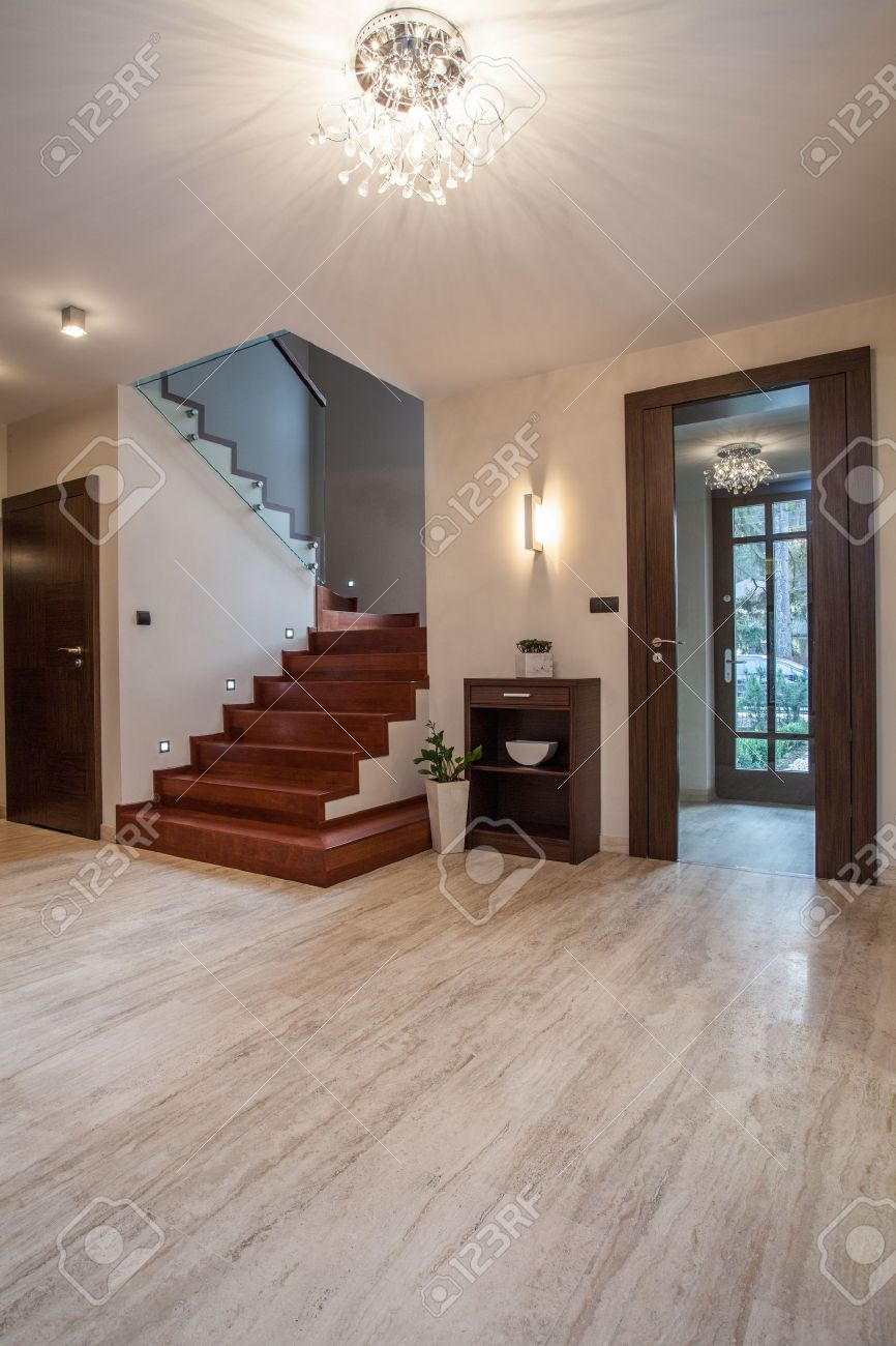 Travertine house: wooden stairs and glass entrance Stock Photo - 16825384