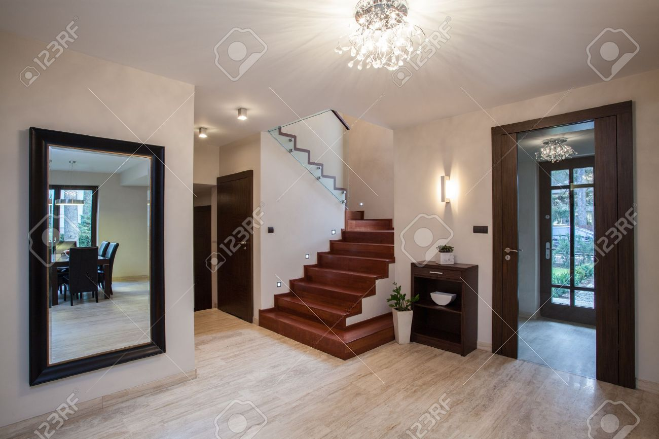 travertine house: interior with hallway, stairs and entrance stock