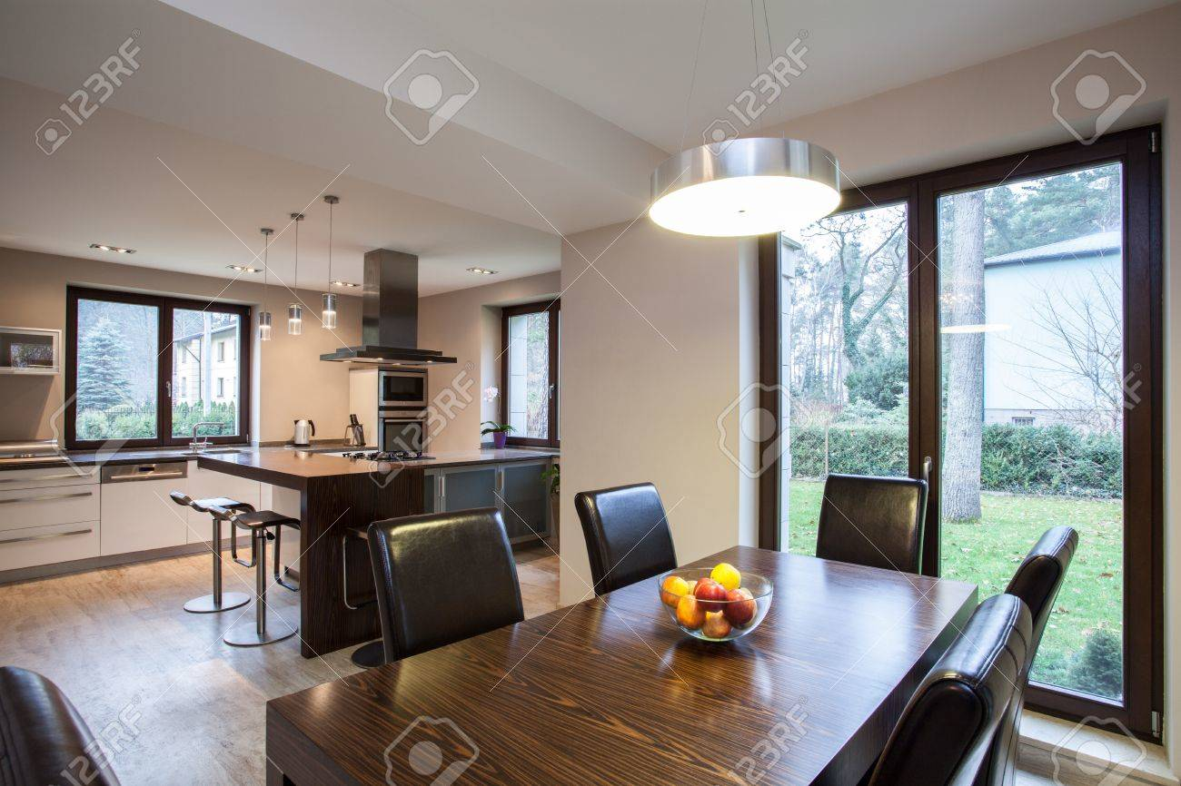 Travertine house - view of a dining room and kitchen Stock Photo - 16841888