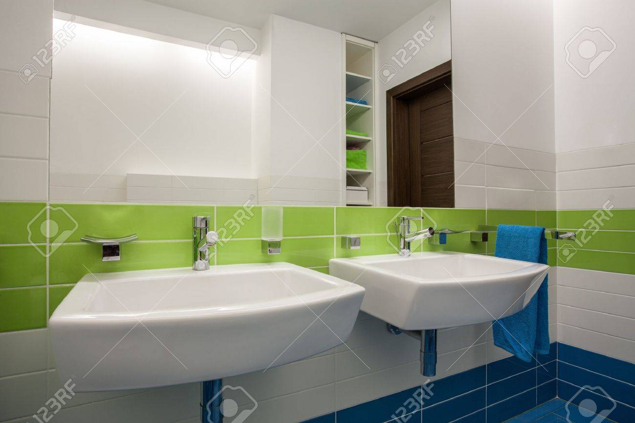 Travertine house - contemporary, colorful bathroom for two children Stock Photo - 16906364