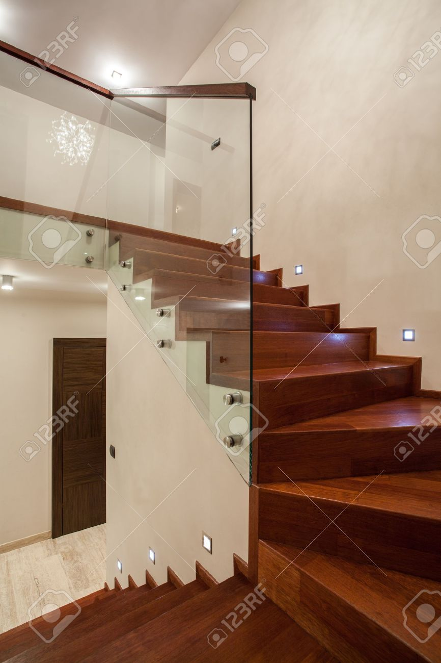 travertine house - wooden glass staircase in modern interior stock