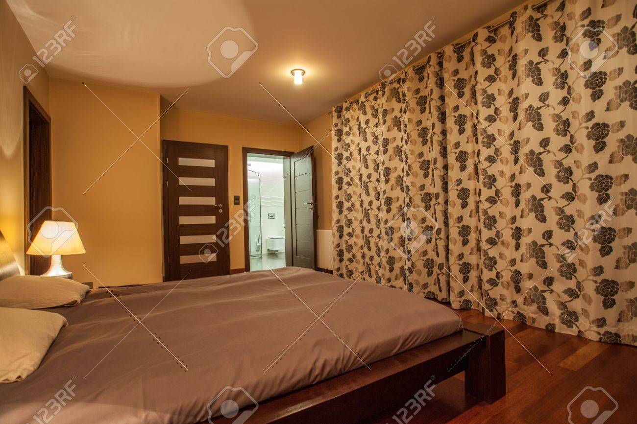 Travertine house - bedroom with wooden bed Stock Photo - 16964478