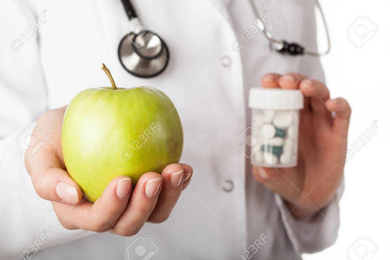 Doctor giving an apple instead of a drugs - 17061000
