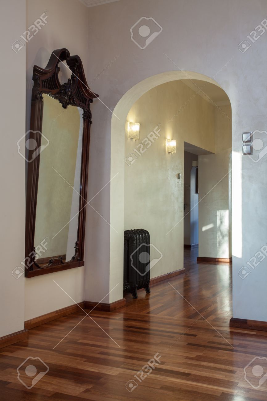 Cloudy home - classic interior with arch and big mirror Stock Photo - 17317921