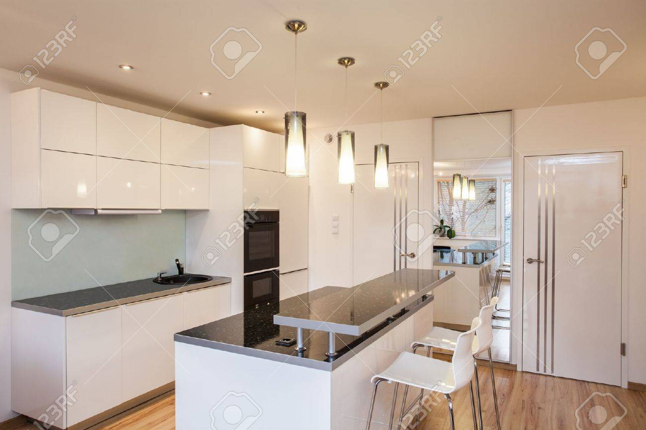 Stylish Flat Interior Of Modern And Bright Kitchen Stock Photo