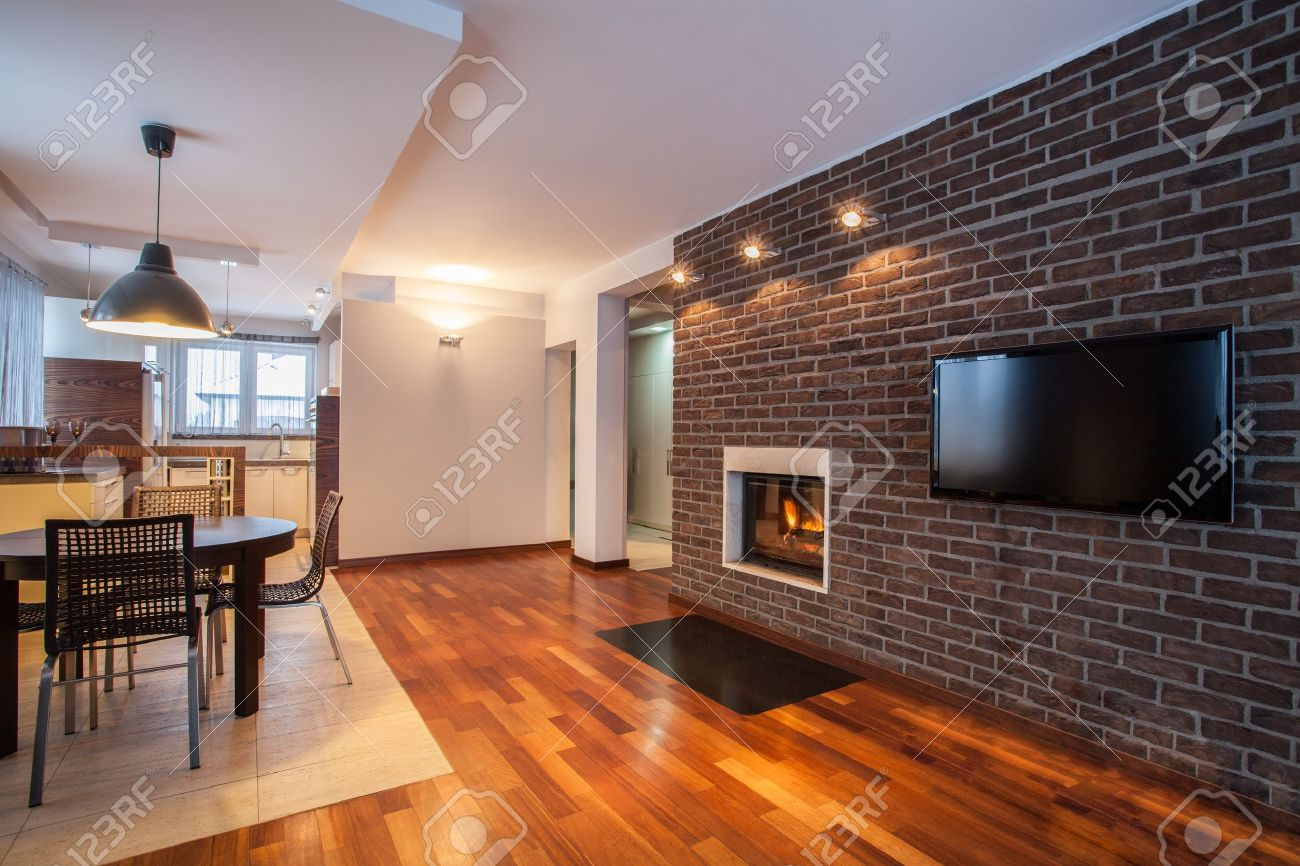 Country home - dining room with brick wall and fireplace Stock Photo - 17861584