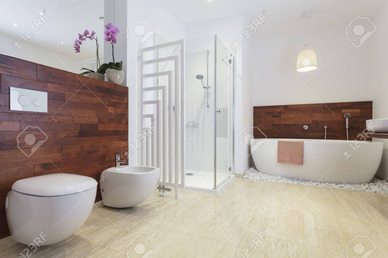 African Style Bathroom With Exotic Wood And Free Standing Bath ...