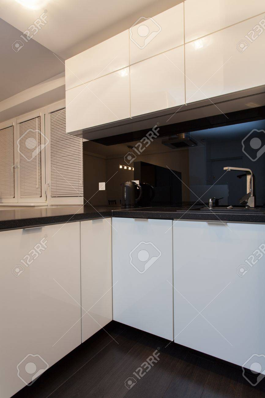 Minimalist apartment - sink and faucet in modern kitchen Stock Photo - 18857436