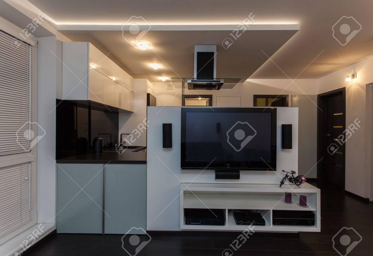 Apartment living room and kitchen - Minimalist Apartment Living Room With A View At Kitchen Stock Photo 18857442
