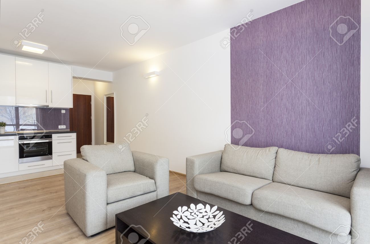 Cosy Flat - Grey Sofa In White And Violet Living Room Stock Photo ...