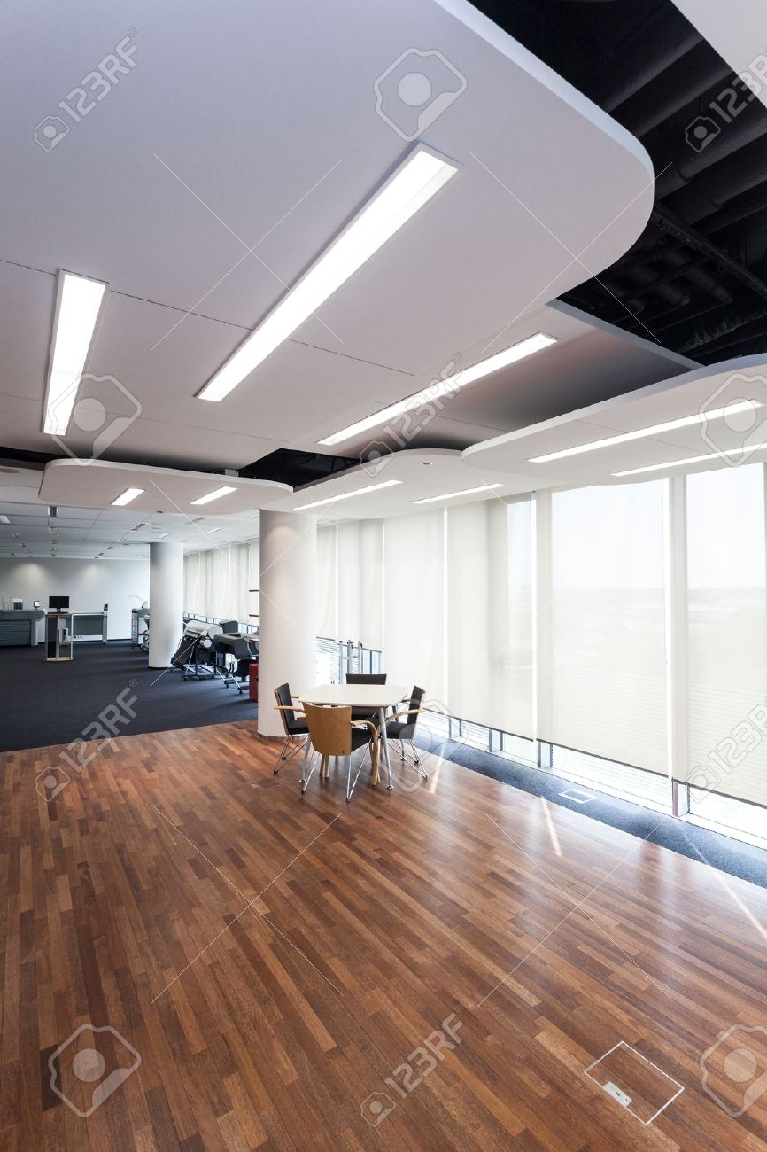 Modern Office With Design Lighting And Wooden Floor Stock Photo