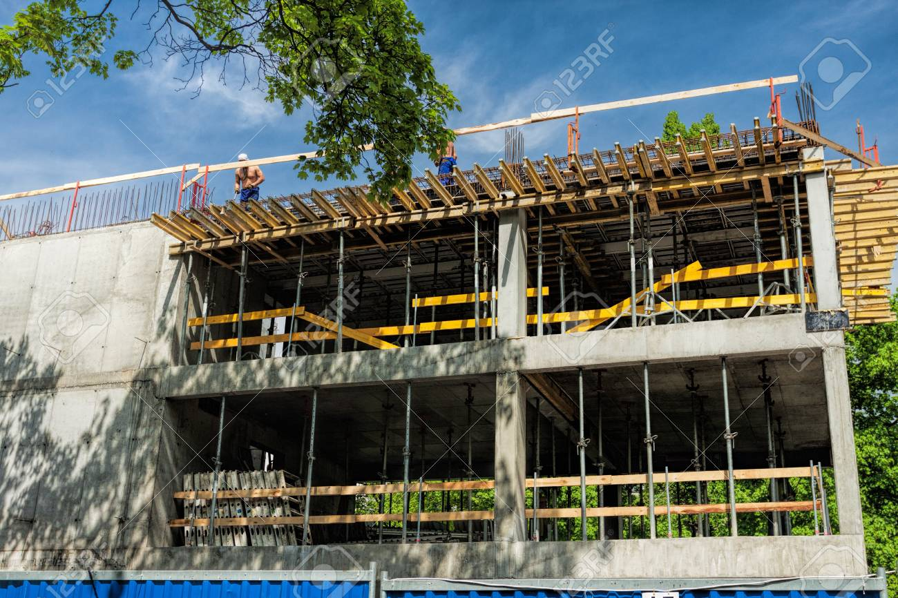 New unfinished construction with workers on a roof Stock Photo - 19913362