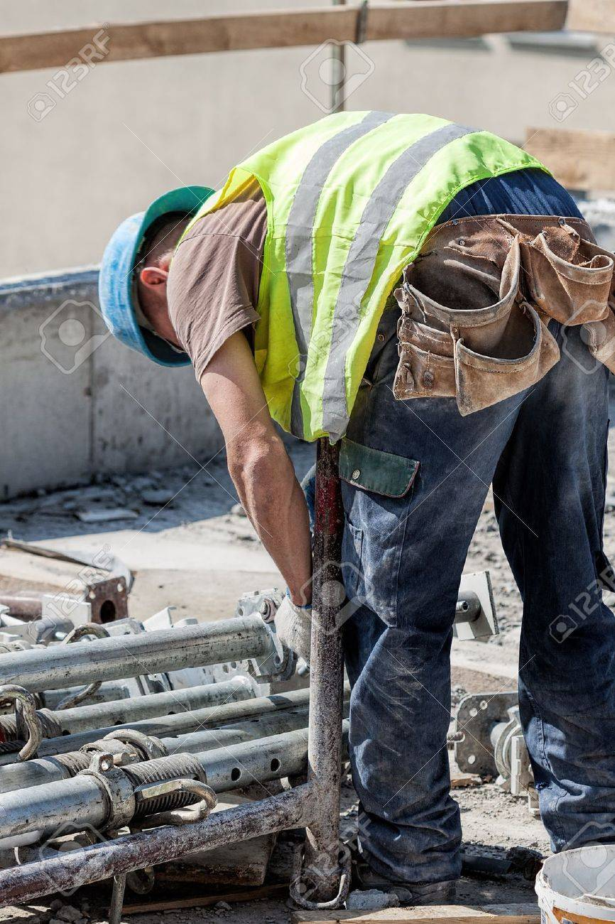 Builder working on a construction site, vertical Stock Photo - 20019330