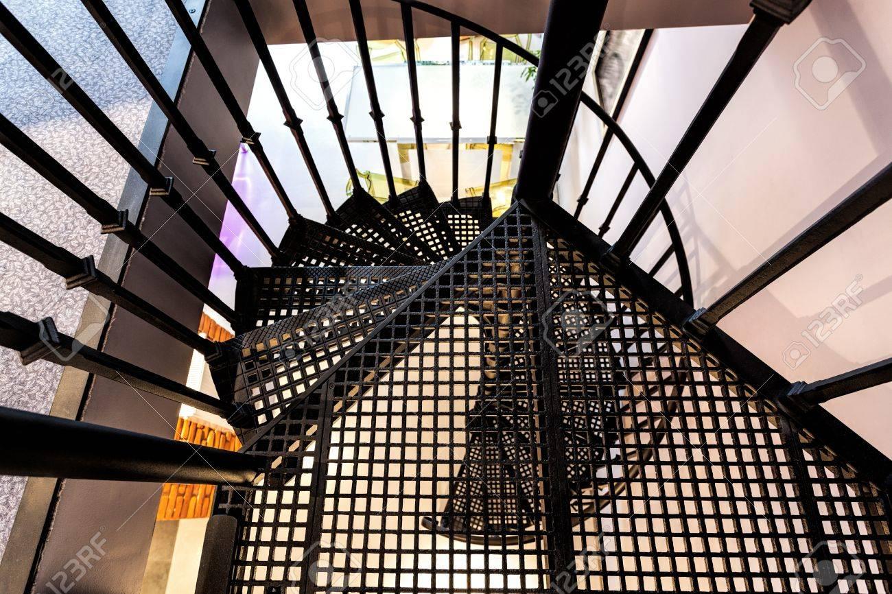 bird eye view of a metal spiral staircase stock photo