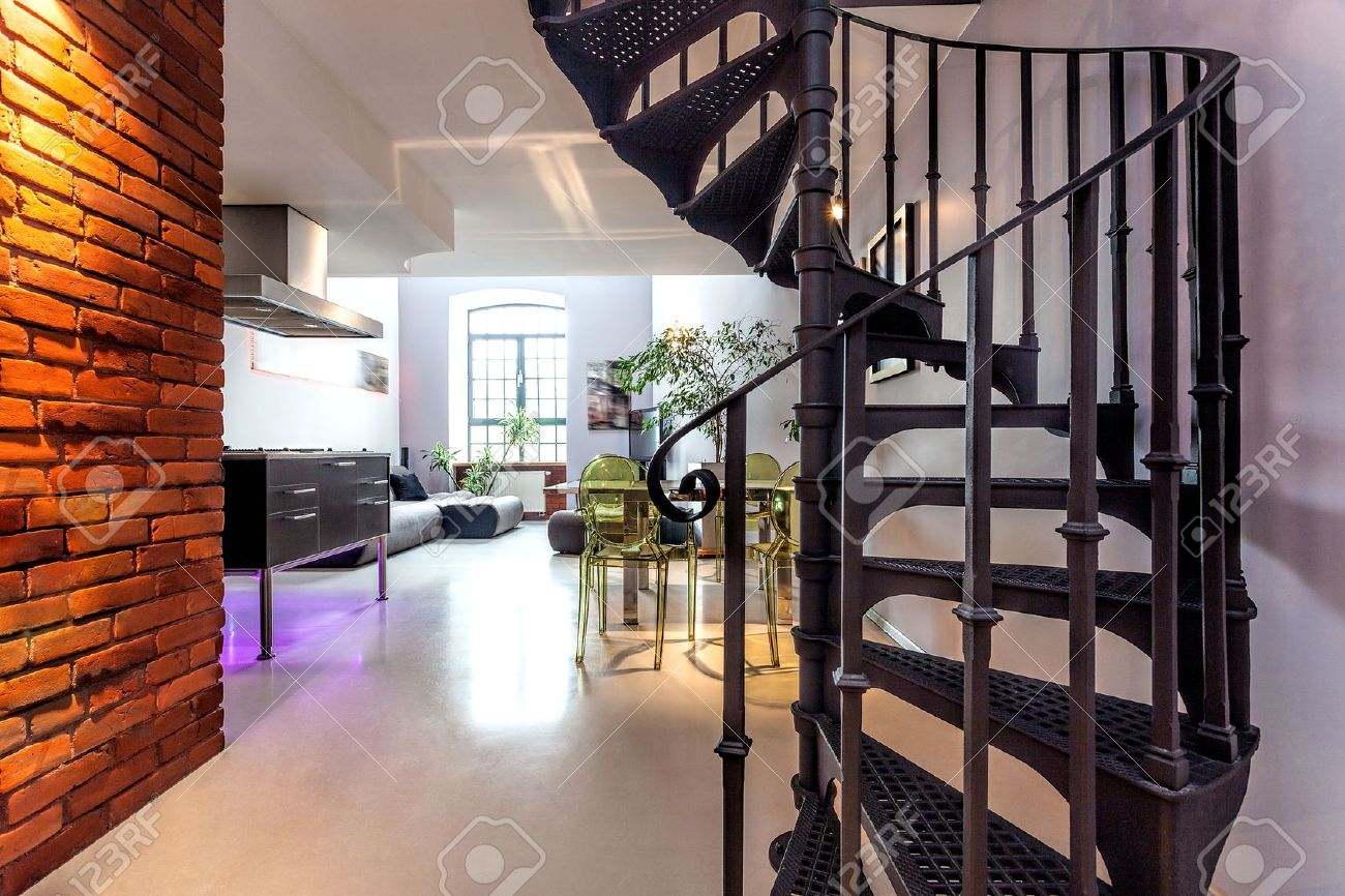 wohnzimmer modern loft : Spiral Stairs And Living Room In Modern Loft Stock Photo Picture