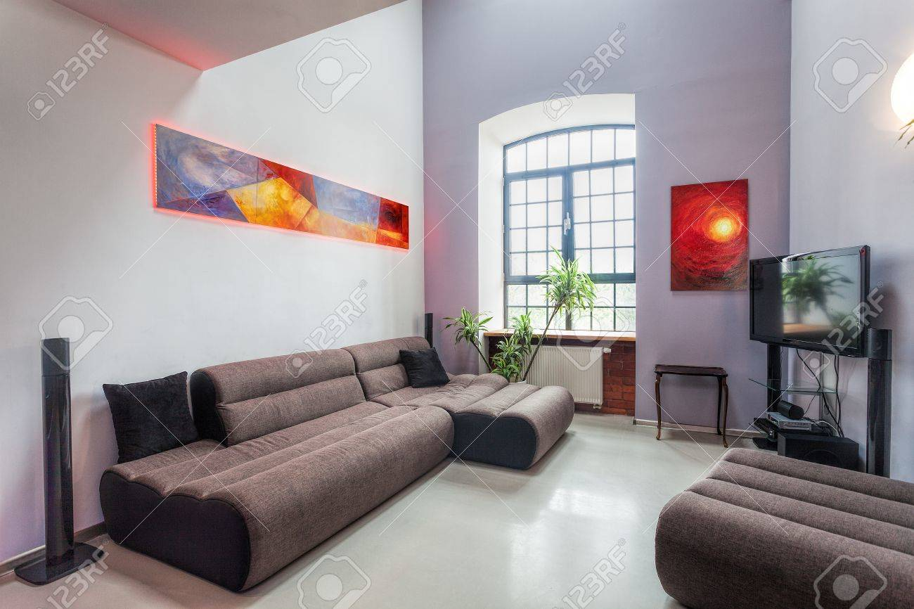 Modern living room interior with comfortable grey sofa Stock Photo - 20639440
