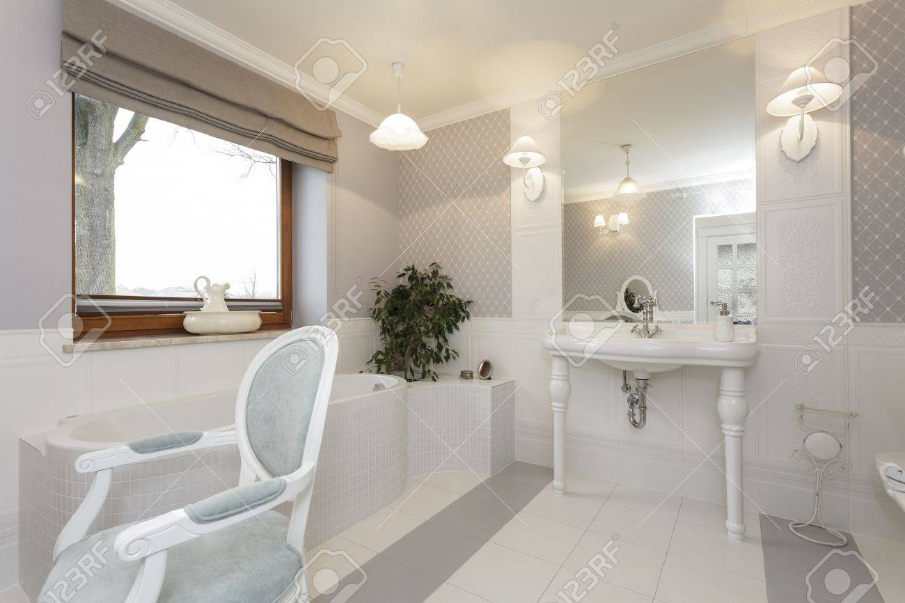 Tuscany - White bathroom with classic chair Stock Photo - 21121951