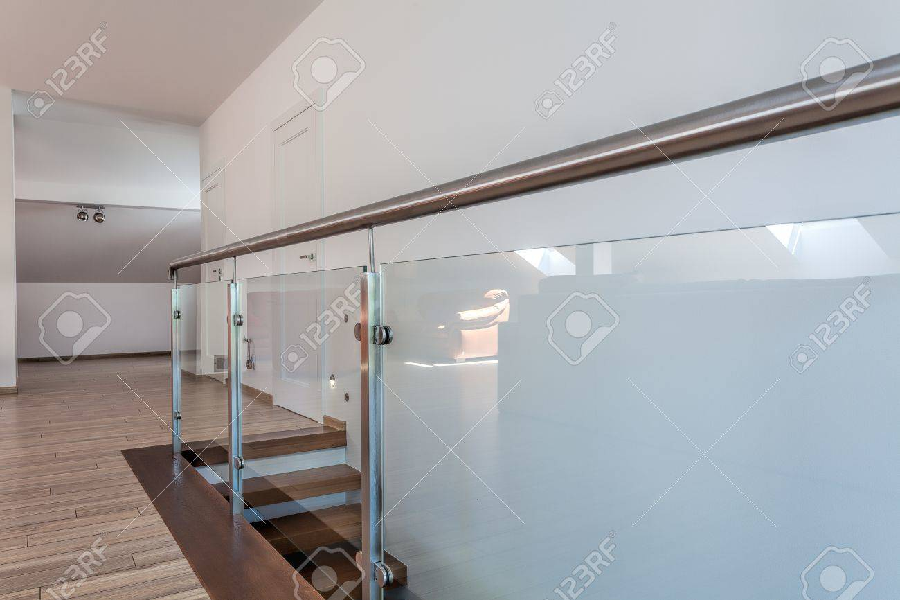 Bright space - stairs with a glass metal barrier Stock Photo - 21132033