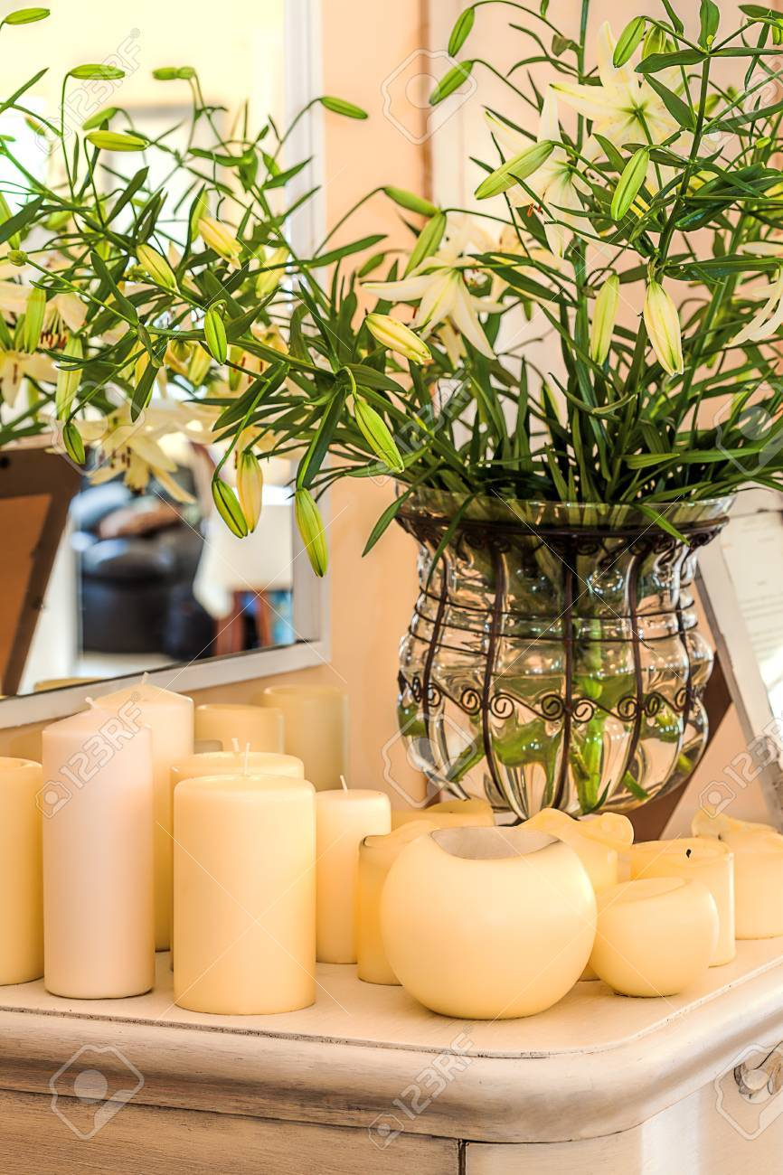 Mediterranean interior - flowers in a vase and cream candles Stock Photo - 21363353