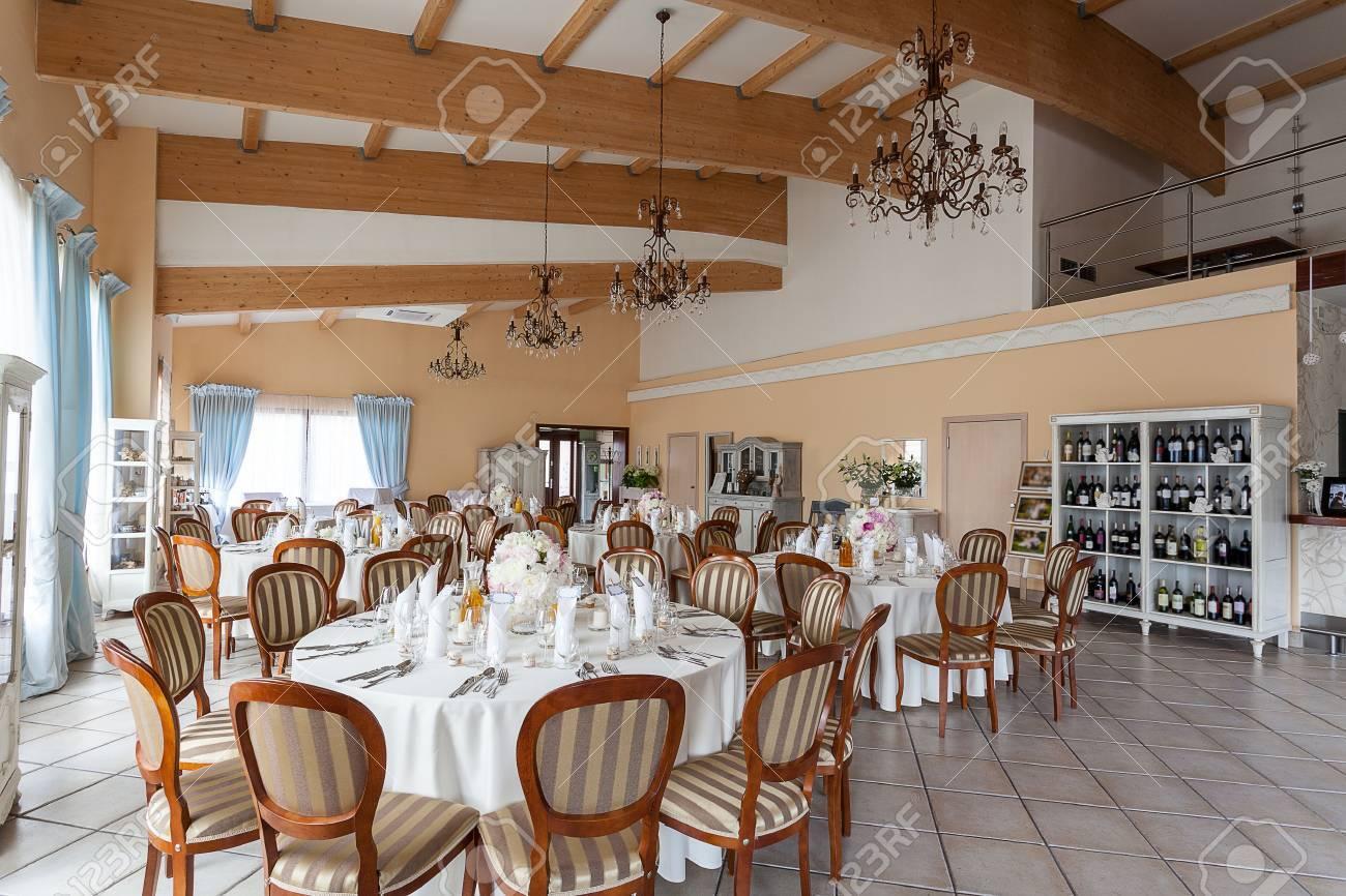 Mediterranean interior - set reception tables in a spacious restaurant Stock Photo - 21363359