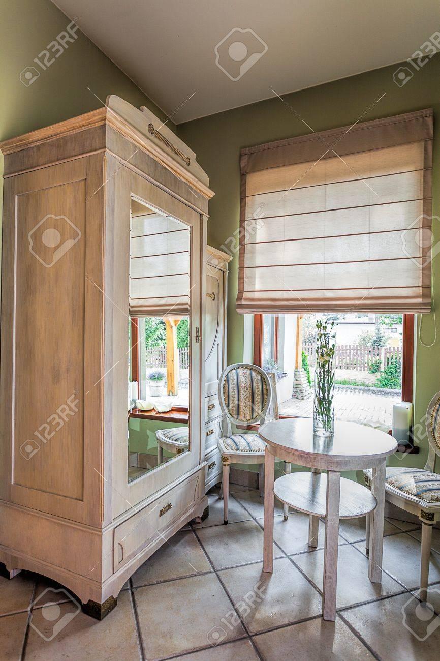 Mediterranean interior - an off-white wooden closet with a mirror Stock Photo - 21363368