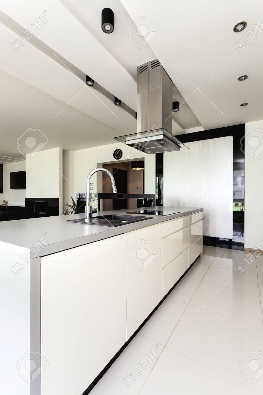 Urban apartment - white and black kitchen in modern house Stock Photo - 21575557