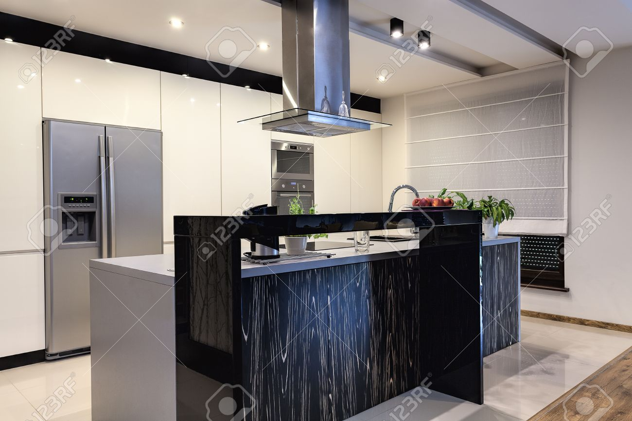 stock photo urban apartment white kitchen with black bar counter