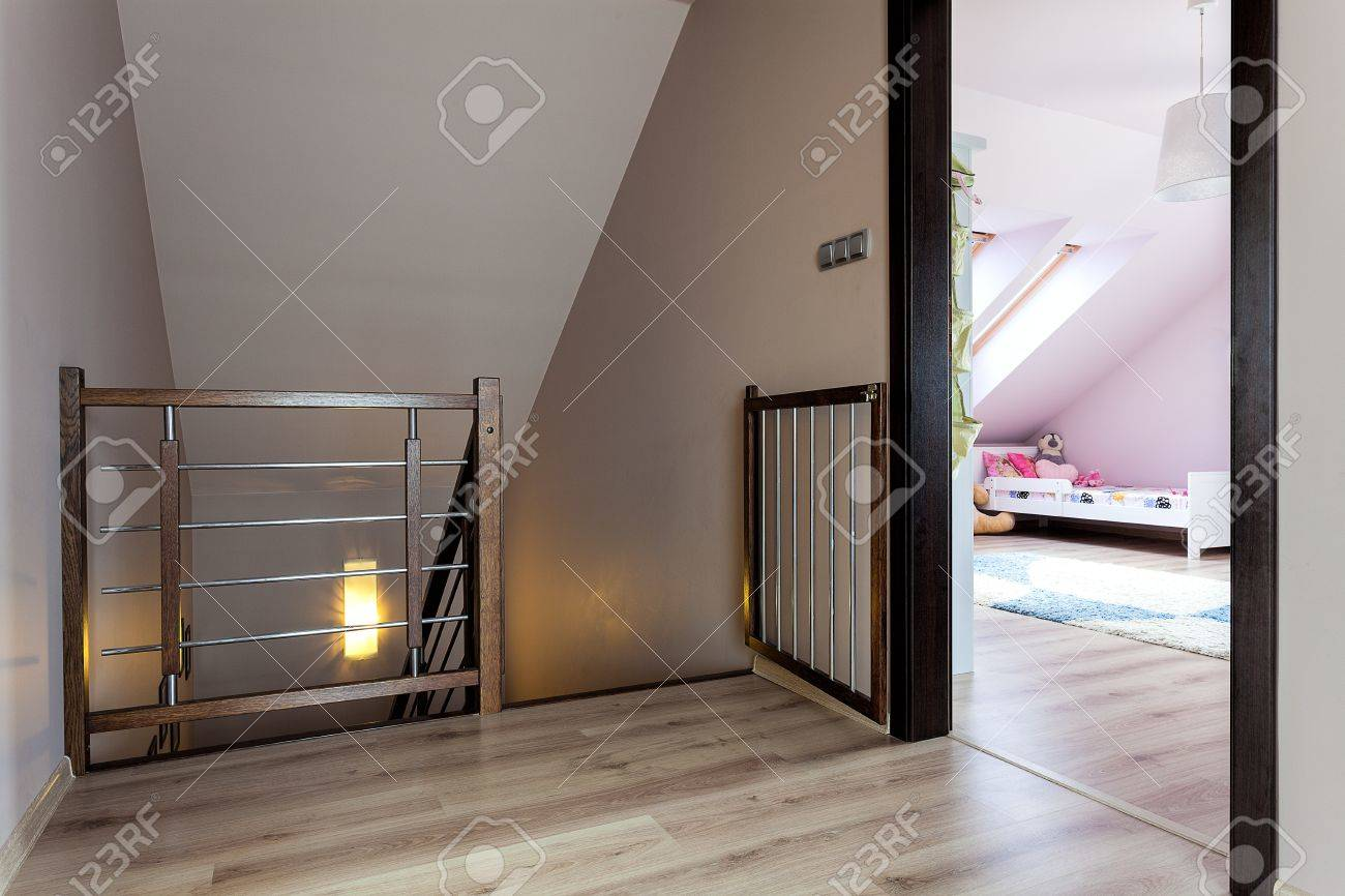Urban Apartment Staircase With A Baby Safety Gate Stock Photo